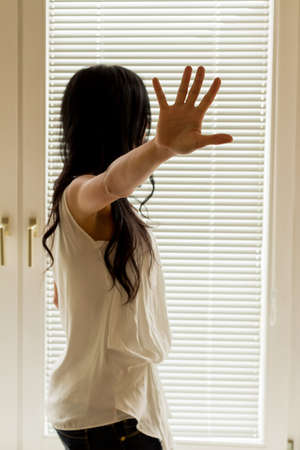 maltreatment: a woman is being harassed and holds his hand to ward