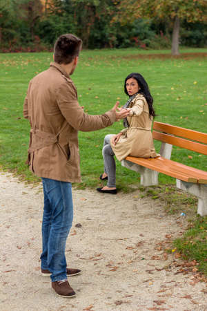 voltages: a young couple sitting on a park bench, and fight