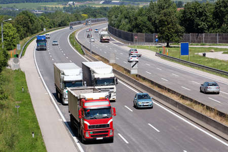 overtake: Trucks on a three-lane highway. symbolic photo for transport of goods
