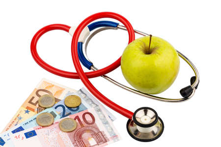stethoskope: An apple and a stethoscope with a doctor. symbolic photo for healthy, vitamin-rich diet.