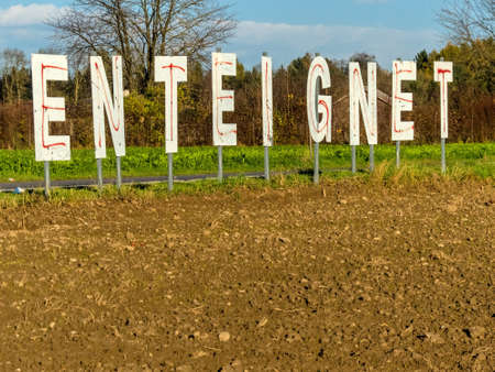 erected: A farmer has the word expropriates erected in his field. Stock Photo