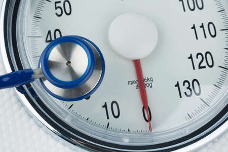 intercept: Stethoscope and scale, symbol photo for weight, diet and heart disease