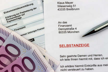 treaties: Symbolic photo for a voluntary disclosure for evasion of taxes at the tax office in germany