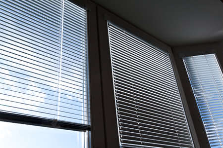 lamellar: Window blinds for sun protection, heat protection Stock Photo