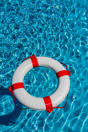 banking crisis: an emergency tire floating in a pool. symbolic photo for rescue and crisis management in the financial crisis and banking crisis.