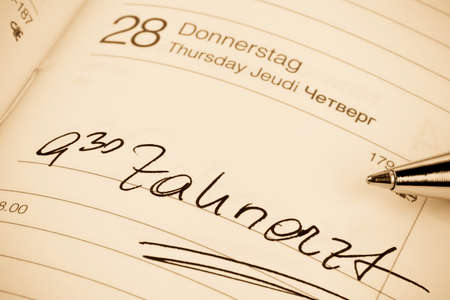 surgery costs: an appointment is entered on a calendar: dentist