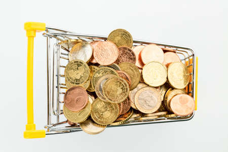 consumerist: a shopping cart filled with euro coins, symbofoto for purchasing power, consumption and inflation
