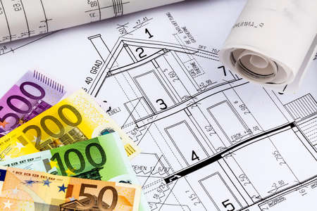 single familiy: a blueprint of an architect with euro money. symbolic photo for financing and planning of a new house. Stock Photo