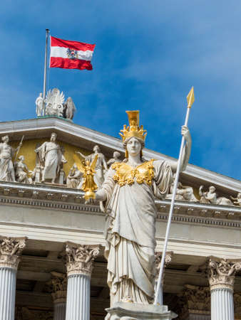 athene: parliament in vienna, austria. with the statue of pallas athena of the greek goddess of wisdom.
