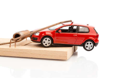 hidden danger: a model car in a mousetrap, symbolfoto for car expenses and liabilities