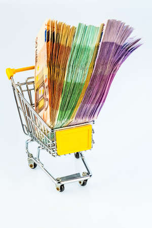 purchasing power: euro banknotes in a shopping cart, photo icon for purchasing power, shopping, money printing and inflation Stock Photo