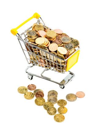 purchasing power: a shopping cart is well stocked with euro coins photo icon for purchasing power and consumption Stock Photo