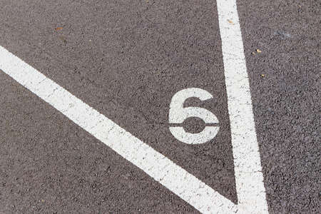 parking spaces: in a parking lot with numbers are the individual parking spaces labeled Stock Photo