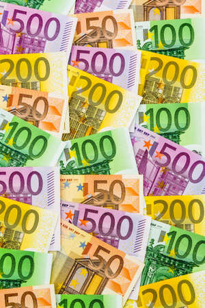 assessment system: many different euro bills. symbolic photo for wealth and investment
