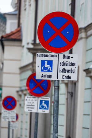 wheelchair users: no stopping sign wheelchair symbol of prohibitions, towing, fine