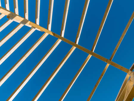 subsidy: in one house a new roof is being built on a construction site. cleats, wood for roof trusses. Stock Photo