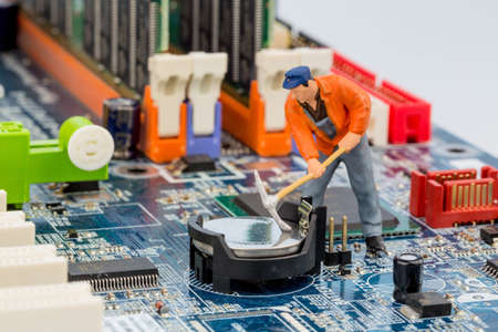 hard drive crash: computer board and workers, symbolfoto for computer failure, maintenance, data security