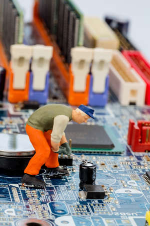 edv: computer board and workers, symbolfoto for computer failure, maintenance, data security