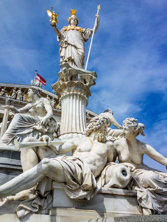athene: parliament in vienna, austria. with the statue of the pallas athene the greek goddess of wisdom.