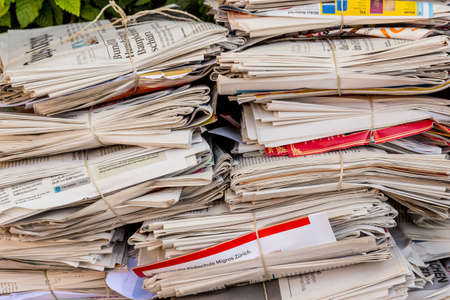 wastepaper: a stack of old newspapers ready for removal by waste paper disposal Stock Photo