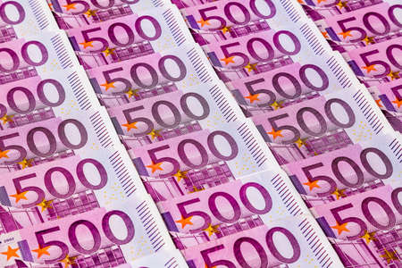 assessment system: many five hundred euro banknotes are adjacent. symbolic photo for wealth and investment