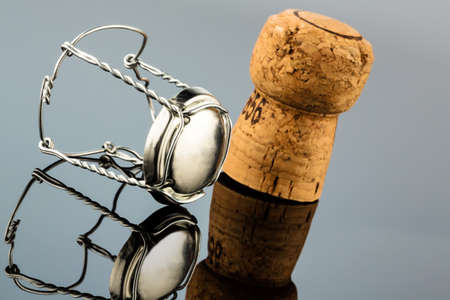 reflection: champagne corks and clasp, symbol photo for celebrations, enjoyment and alcohol consumption Stock Photo