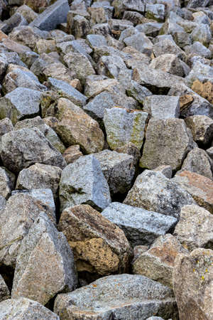 next to each other: a stack of natural stone located next to each other. symbol photo
