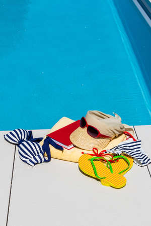 laze: utensils for a nice relaxing vacation day lying next to a swimming pool. relaxation on vacation. Stock Photo