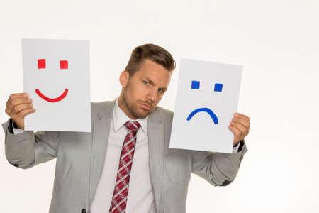 joie: ein Manager oder Unternehmer kann sich nicht entscheiden, ob er lachen oder weinen soll