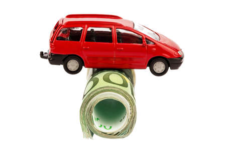 upkeep: a car standing on euro bills. costs for the purchase of automobiles, gasoline, insurance and other car costs