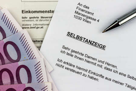 treaties: symbolic photo for a voluntary disclosure for evasion of taxes at the tax office in austria Stock Photo