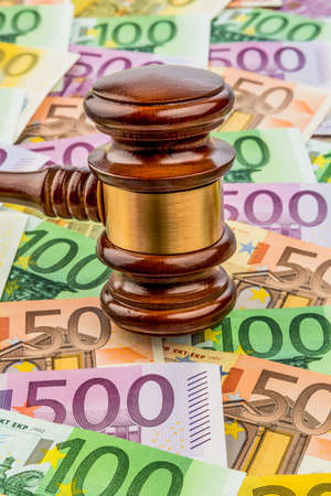 banknote: gavel and euro banknotes. symbol photo for costs in court, rule of law and auctions Stock Photo