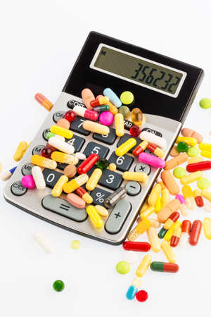 investigated: many colorful pills on a white background. symbolic photo for medicine and drugs