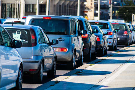in rush hour traffic jam cars on a street in downtown. problems in city traffic Archivio Fotografico