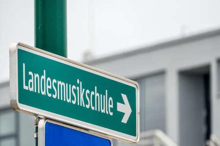 dispute: landesmusikschule signs, symbol of education, culture, music, direction dispute