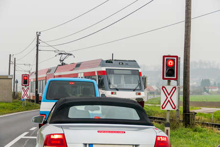 railway transportations: car on a level crossing, symbol for auto transport, rail transport, mobility