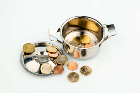 pot hole: a pot with a few euro coins symbol photo for sovereign debt and financial crisis Stock Photo