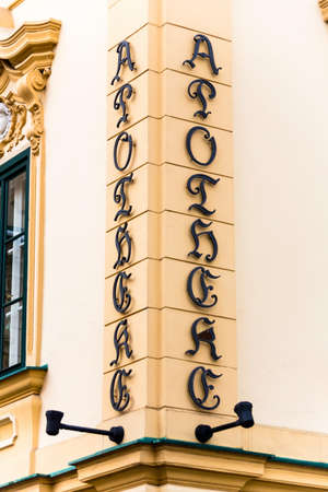 perpendicular: old pharmacy, sign of letters on the facade