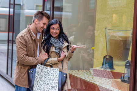 young couple einkausbummel. shopping in the city i enjoy Stock Photo