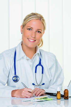 physican: a young doctor prescribes medication. prescription pills are prescribed by a doctor. Stock Photo