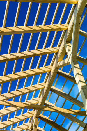 societies: wooden roof construction, symbolfoto for home, home construction, and home financing