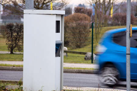 too fast: a box on a road with a radar device to control the speed.