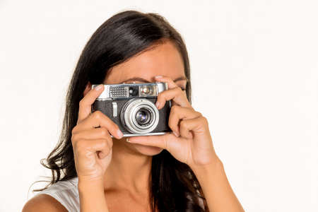snap: a young woman photographed with a retro camera