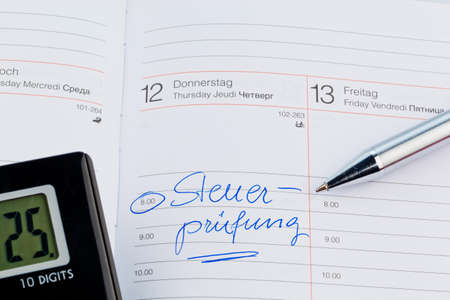 entered: an appointment is entered on a calendar: tax audit Stock Photo