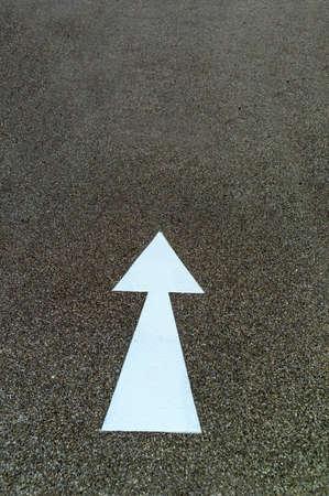 clear path: arrow as a direction marker on a bike path in linz, austria