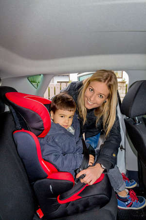 child seat: boy in a child seat, a symbol of protection, care, vehicle safety