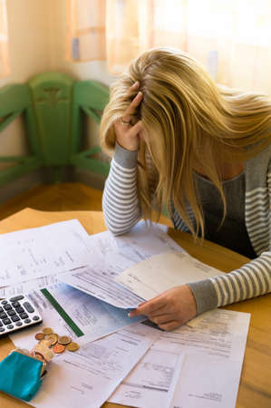 helplessness: a woman with unpaid bills has many debts. unemployment and personal bankruptcy Stock Photo