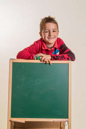 general knowledge: a child with a blank blackboard.