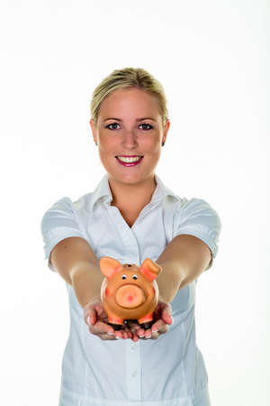 money and saving: young woman holding a piggy bank saving money for a rainy day.