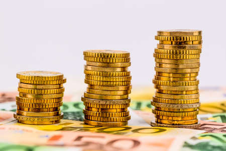 immobilien: stack coins, rising curve, symbol photo for increasing profits and rising costs